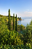 CORFU, GREECE - THE KASSIOPIA ESTATE. VIEW FROM THE VILLA LOOKING OUT TO SEA WITH CYPRESS TREES