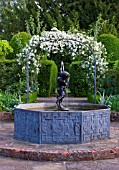 BIRTSMORTON COURT, WORCESTERSHIRE: WHITE GARDEN - LEAD POOL / POND WITH CHERUB FOUNTAIN AND METAL ARCH WITH ROSE SNOWDRIFT. COUNTRY GARDEN, CLASSIC, ENGLISH