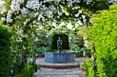 BIRTSMORTON COURT, WORCESTERSHIRE: WHITE GARDEN - LEAD POOL / POND WITH CHERUB FOUNTAIN, WHITE DELPHINIUMS AND METAL ARCH WITH ROSE WICKWAR. COUNTRY GARDEN, CLASSIC, ENGLISH