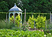 POULTON HOUSE GARDEN, WILTSHIRE: TIMBER AND LEAD PAVILLION IN THE KITCHEN GARDEN WITH SWEET PEAS