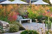 HORATIOS GARDEN  SALISBURY HOSPITAL  WILTSHIRE - DESIGNER CLEEVE WEST - BORDER WITH BENCH/ SEAT  CENTRANTHUS RUBER  STIPA GIGANTEA WITH ACANTHUS AND ARUNCUS DIOICUS