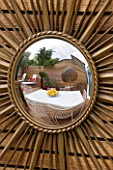 BEN DE LISI HOUSE AND GARDEN  LONDON: FRENCH SIXTIES SUNBURST MIRROR ON WALL