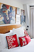 BEN DE LISI HOUSE AND GARDEN  LONDON: MASTER BEDROOM WITH BED AND BEN DE LISI DOG CUSHIONS