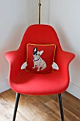 BEN DE LISI HOUSE AND GARDEN  LONDON: RED CHAIR IN LIVING ROOM WITH BEN DE LISI DOG CUSHION
