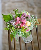 COMMON FARM FLOWERS, SOMERSET, SUMMER: FRESHLY CUT FLOWERS IN GLASS VASE ON BACK OF CHAIR - FLOWER, FLOWERS, BOUQUET, DISPLAY, ARRANGEMENT, FLORAL, ALCHEMILLA MOLLIS, ROSES