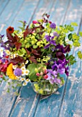 COMMON FARM FLOWERS, SOMERSET, SUMMER: FRESHLY CUT FLOWERS IN GLASS CONTAINER ON BLUE BENCH / TABLE - FLOWER, FLOWERS, BOUQUET, DISPLAY, ARRANGEMENT, FLORAL, CORNFLOWER, ALCHEMILLA