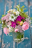 COMMON FARM FLOWERS, SOMERSET, SUMMER: FRESHLY CUT FLOWERS IN GLASS CONTAINER ON BLUE BENCH / TABLE - FLOWER, BOUQUET, DISPLAY, ARRANGEMENT, FLORAL, ROSES, ACHILLEA, NIGELLA