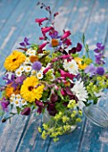 COMMON FARM FLOWERS, SOMERSET, SUMMER: FRESHLY CUT FLOWERS IN GLASS CONTAINER ON BLUE BENCH / TABLE - FLOWER, BOUQUET, DISPLAY, ARRANGEMENT, FLORAL, ALCHEMILLA, PENSTEMON