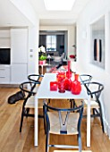 BEN DE LISI HOUSE  LONDON: THE KITCHEN WITH DINING AREA - WHITE TABLE AND RED GLASS WITH VINTAGE MURANO PIECES