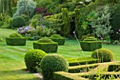 WOOLSTONE MILL HOUSE, OXFORDSHIRE: VIEW FROM FORMAL PARTERRE WITH BOX FONDANTS AND BOX BALLS. GREEN, TOPIARY.