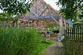 MARCHANTS HARDY PLANTS, EAST SUSSEX: THE NURSERY - TIMBER SHELTER WITH LATH ROOF. WOOD