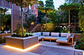 PRIVATE GARDEN LONDON: DESIGNER STEPHEN WOODHAMS - TOWN GARDEN - BACK GARDEN - TRELLIS, MIRROR,  RAISED BED WITH PLATANUS X ACERIFOLIA.SEATING, FORMAL, CITY GARDEN, LIGHTING, LIT
