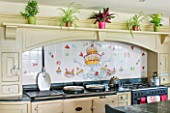 BRILLS FARM  LINCOLNSHIRE: THE KITCHEN WITH TILES PAINTED BY KATE GLANVILLE