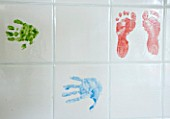 BRILLS FARM  LINCOLNSHIRE: THE KITCHEN WITH TILES PAINTED WITH THE CHILDRENS FEET AND HANDS
