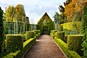 EAST RUSTON OLD VICARAGE GARDEN, NORFOLK: THE LONG BORDERS WITH GRAVEL PATH, CLIPPED TOPIARY BOX HEDGING AND HORNBEAM TOPIARY HOUSE - SPRING, VIEW, VISTA, TRIMMED, HEDGE