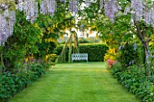 THE MANOR HOUSE, STEVINGTON, BEDFORDSHIRE: THE LABURNUM ARCH AND WISTERIA ARCH AT DAWN