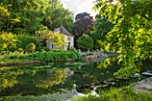 ABLINGTON MANOR  GLOUCESTERSHIRE: VIEW ACROSS RIVER COLN TO FRENCH STYLE GAZEBO / SUMMER HOUSE  CLASSIC COUNTRY GARDEN  SUMMER  JUNE  ROMANCE  ROMANTIC
