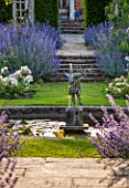 GREAT FOSTERS, SURREY: THE ROSE GARDEN IN JUNE: FOUNTAIN, CATMINT - NEPETA FAASSENII, ARBOUR, POOL, POND, STATUE, FORMAL, SUMMER, ENGLISH GARDEN, ROSES, CLASSIC, ROMANTIC