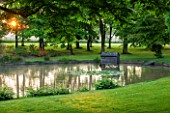 LITTLE MYNTHURST FARM, SURREY: SUNRISE - LAWN ADN POND WITH TREES. POOL, LAKE, GARDEN, SUMMER, COUNTRY