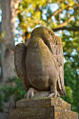 PRIVATE GARDEN, GLOUCESTERSHIRE - DESIGNER ANGEL COLLINS - STONE BIRD ON TOP OF GATE