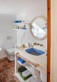 CIUTADELLA MENORCA, SPAIN: EVELYNE MANDEL HOUSE - BATHROOM IN BLUE AND WHITE - MIRROR, SINK, WASHBASIN, WASH BASIN, TAPS, LIGHT, SOAP, TOILET