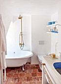 CIUTADELLA MENORCA, SPAIN: EVELYNE MANDEL HOUSE - BATHROOM IN BLUE AND WHITE - SINK, WASHBASIN, WASH BASIN, TAPS, LIGHT, SOAP, TOILET, BATH, CLASSIC ROLL TOP, SHOWER, FREE STANDING