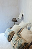 CIUTADELLA MENORCA, SPAIN: EVELYNE MANDEL HOUSE - MASTER BEDROOM -  WHITE BED LINEN, BLUE AND BLUE AND WHITE CUSHIONS AND TABLE LAMP