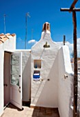 CIUTADELLA MENORCA, SPAIN: EVELYNE MANDEL HOUSE - WHITE PAINTED WALLS - OUTDOOR SHOWER ON ROOF TOP TERRACE