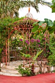 JONATHAN BAILLIE GARDEN, ALAIOR, MENORCA: PAINTED INDIAN WROUGHT IRON PAVILION/ GAZEBO