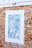 JONATHAN BAILLIE GARDEN, ALAIOR, MENORCA: ABSTRACT PAINTING ON HOUSE WALL IN BLUE AND WHITE