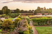 LAMPORT HALL, NORTHAMPTONSHIRE: AERIAL VIEW OF THE WALLED CUTTING FLOWER GARDEN WITH THE ROCKERY GARDEN IN THE FOREGROUND. FORMAL, HISTORIC, CLASSIC ENGLISH GARDEN