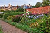 LAMPORT HALL, NORTHAMPTONSHIRE: THE HALL SEEN FROM THE WALLED KITCHEN GARDEN - CUTTING GARDEN - JOE PYE WEED, HOLLYHOCKS, AGAPANTHUS - FLOWERS, SUMMER, COUNTRY GARDEN