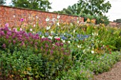LAMPORT HALL, NORTHAMPTONSHIRE: BORDER IN THE WALLED KITCHEN GARDEN - CUTTING GARDEN WITH AGAPANTHUS, JOE PYE WEED - EUPATORIUM AND HOLLYHOCKS - FLOWERS, AUGUST, SUMMER