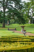 LAMPORT HALL, NORTHAMPTONSHIRE: VIEW OVER THE ITALIAN PARTERRE GARDEN TO URNS AND CEDAR TREE BEYOND. LAWN, FORMAL, CLASSIC ENGLISH, COUNTRY GARDEN