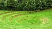 GREAT FOSTERS. SURREY: LANDFORM BY KIM WILKIE - AMPHITHEATRE, CIRCLE, ART, HISTORIC, LAWNS, GRASS, PATTERN