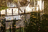 THE LYNDALLS, HEREFORDSHIRE: REFLECTION OF HOUSE IN POOL / POND