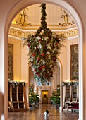 CASTLE HOWARD, YORKSHIRE: CHRISTMAS - DEE THE DOG SITS BENEATH AN ENORMOUS HANGING DECORATION IN THE OCTAGON - DECORATIVE, ORNAMENT, WINTER, BAUBLES, FESTIVE, ANIMAL, PET