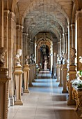 CASTLE HOWARD, YORKSHIRE: CHRISTMAS - THE ANTIQUE PASSAGE DECORATED AT CHRISTMAS WITH WHITE ORCHIDS - DECORATIVE, ORNAMENT, FESTIVE, WINTER, NOVEMBER