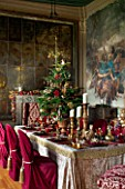 CASTLE HOWARD, YORKSHIRE: CHRISTMAS - DINING ROOM IN THE HIGH SALOON DECORATED FOR CHRISTMAS WITH CANDLES, CHRISTMAS TREES AND FESTIVE DECORATIONS - DECORATIVE, ORNAMENT, WINTER