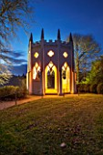 PAINSHILL PARK, SURREY: THE GOTHIC TOWER LIT UP AT NIGHT - LIGHTING, HISTORIC, LANDSCAPE, WINTER, DECEMBER, CHRISTMAS, FOLLY, BUILDING