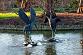 RHS GARDEN, WISLEY, SURREY: BIRD SCULPTURES IN THE LAKE AT SEVEN ACRE, IN WINTER. ART, WATER