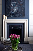 SALLY STOREY HOUSE, LONDON: OPEN PLAN SITTING ROOM / HALL WITH FIREPLACE, PAINTING BY SALLYS DAUGHTER LUCCA, CHIMNEY PAINTED IN FARROW & BALL DOWNPIPE