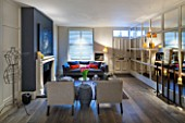SALLY STOREY HOUSE, LONDON: OPEN PLAN SITTING ROOM / HALL WITH FIREPLACE, PAINTING, MIRRORED WALL, MIRROR, SETTEE, CHAIRS, RUG, LIGHT, CHIMNEY PAINTED IN FARROW & BALL DOWNPIPE
