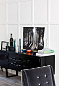 SALLY STOREY HOUSE, LONDON: OPEN PLAN SITTING ROOM / HALL WITH GREY CHAIR AND BLACK SIDEBOARD WITH PAINTING