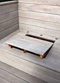 SALLY STOREY HOUSE, LONDON: ROOF TERRACE WITH FAKE WOODEN DECKING AND LID OF STORAGE AREA WITH HOLES FOR FINGERS TO LIFT LID. ROOF GARDEN, DECK, TOWN GARDEN, MODERN