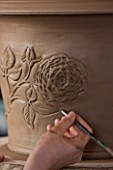 WHICHFORD POTTERY, WARWICKSHIRE: SAS COOPER FETTLING THE TUDOR ROSE DESIGN ON QUEENS 90TH BIRTHDAY TERRACOTTA CONTAINER IN WORKSHOP