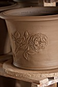 WHICHFORD POTTERY, WARWICKSHIRE: THE TUDOR ROSE DESIGN ON QUEENS 90TH BIRTHDAY TERRACOTTA CONTAINER IN WORKSHOP