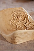 WHICHFORD POTTERY, WARWICKSHIRE: TUDOR ROSE MOULD FOR QUEENS 90TH BIRTHDAY TERRACOTTA CONTAINER IN WORKSHOP