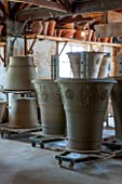 WHICHFORD POTTERY, WARWICKSHIRE: LARGE NEWLY THROWN BESPOKE 3 PIECE ACANTHUS TERRACOTTA CONTAINERS DRYING OUT IN THE WORKSHOP