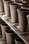 WHICHFORD POTTERY, WARWICKSHIRE: NEWLY THROWN TERRACOTTA CONTAINERS DRYING OUT IN THE WORKSHOP